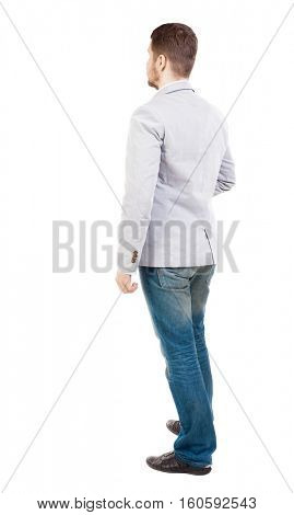 back view of Business man  looks.  Rear view people collection.  backside view of person.  Isolated over white background. A guy in a white jacket standing sideways.