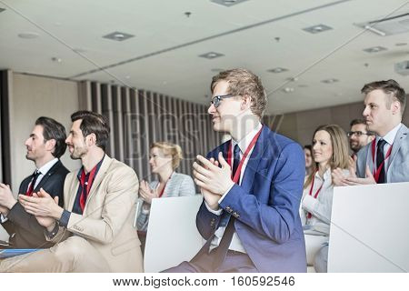 Business people applauding during seminar