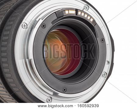 The lens of modern digital camera rear view of the lens. Isolated on white background.