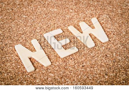 NEW word alphabet wood on wooden background.