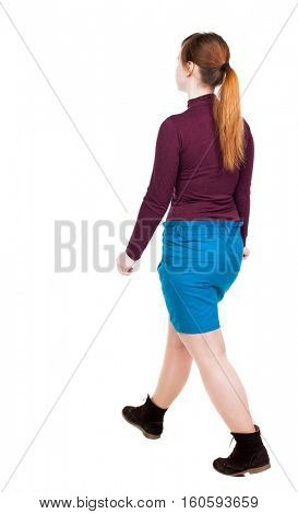side view of walking  woman in dress. beautiful girl in motion.  backside view of person. Rear view people collection. Isolated over white background. girl in a blue skirt and red jacket goes to right