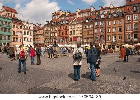 Poland- Warsaw, May 2007.Mermaid statue on square of the old town and a lot of walkers and touristsi May 2007 in Warsaw.Editorial. Horizontal view.