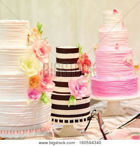 Three Wedding Cakes On A Dessert Table
