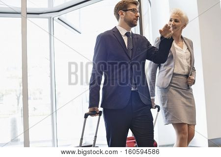 Business people talking while walking in convention center
