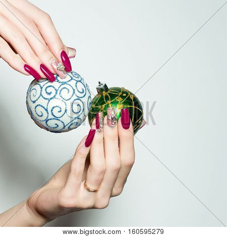 Female Hands Hold Christmas Baubles