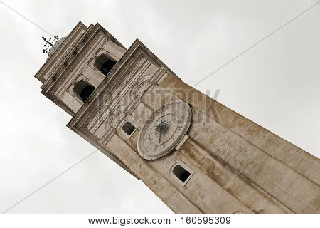 church bell tower with clockface in venice, Italy