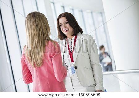 Businesswomen talking in convention center