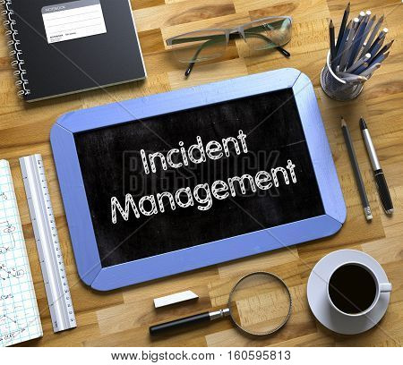 Incident Management - Text on Small Chalkboard.Top View of Office Desk with Stationery and Blue Small Chalkboard with Business Concept - Incident Management. 3d Rendering.
