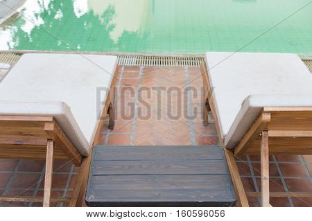 Wood Table And Pool Chair For Resting And Relaxing At Swimming Pool