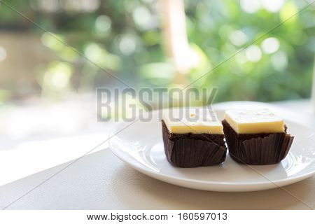 Cream Cheese Brownie With Green Bokeh Background, Selective Focus