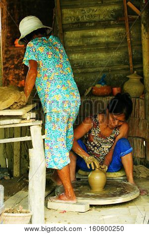 HOIAN, VIETNAM - JUL 25: Workers making handmade creations at Thanh Ha ancient ceramic village in Hoi An town, Vietnam, on July 25, 2010.