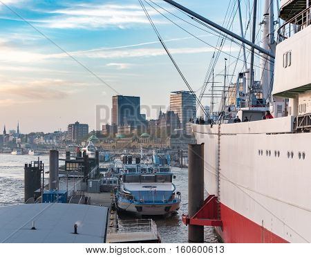 Hamburg, Germany - November 01, 2015: Famous museum ship Cap San Diego and sightseeing boats line up along the gangways of the harbor of Hamburg.