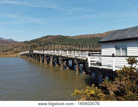 Toll Bridge at Penmaenpool over the River Mawddach estuary on the coast of Cardigan Bay Gwynedd Wales.