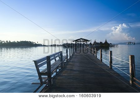 wooden walkway to water bungalow resort hotel mabul island at sunset sabah malaysian borneo