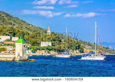 Waterfront view at coastline in town Bol on Island Brac, popular touristic destination on Adriatic Sea, Croatia.