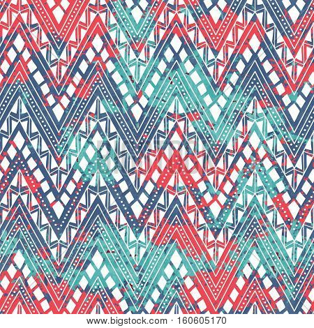 Bright seamless pattern. Ethnic and tribal motifs. Texture of blue, pink and turquoise spots. White geometrical ornament. Horizontal lines in the form of a zigzag. Vector illustration.