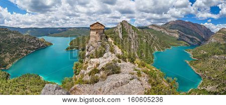 Hermitage of La Pertusa over the Canelles reservoir in La Noguera Lleida province Catalonia Spain