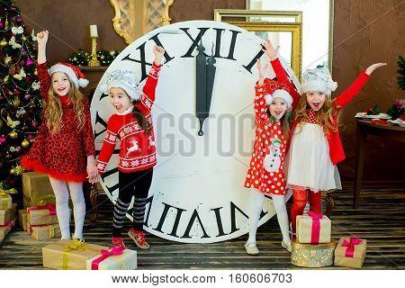 Beautiful Little Girls With A Big Clock