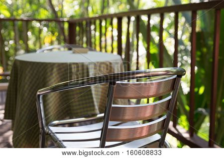 metal chair on terrace balcony near garden park