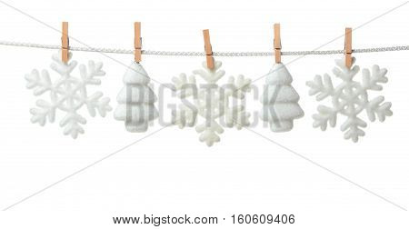 Christmas baubles in shape of snowflake and spruce on white background