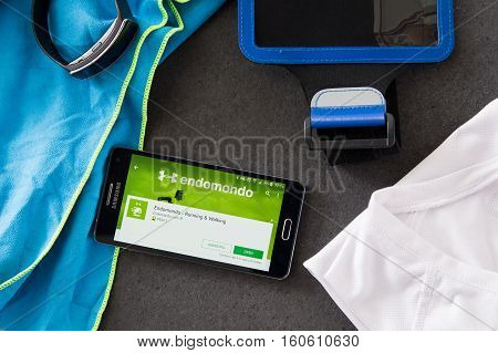 WROCLAW POLAND - DECEMBER 06th 2016: Samsung A5 with Endomondo application laying on desk. Endomondo is a social fitness network created by Endomondo LLC which allows users to track their fitness statistics with a mobile app and website.