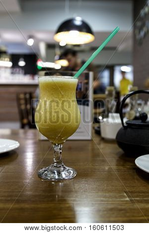 Drink smoothies in a glass on a table against cafe