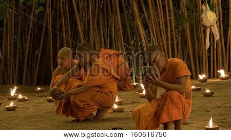 Buddhist Monk Light Candle In Yeepeng Festival