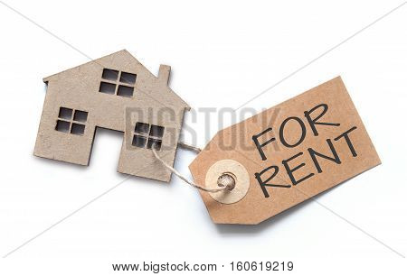 Label attached to miniature house over a white background