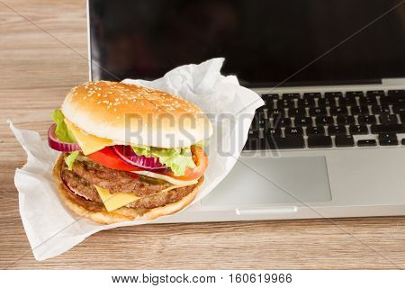 Lunch at work place  fast food near laptop