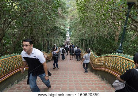 Tourists, Foreigner Travelers And Thai People Walk Up Stairs To Go To Golden Pagoda At Wat Phra That