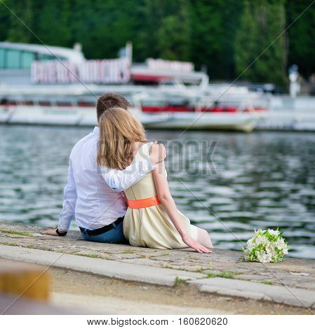 Newly-wed Couple Sitting On The Seine Embankment