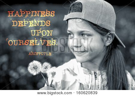 happiness depends upon ourselves - ancient Greek philosopher Aristotle quote printed on image of happy girl with dandelions