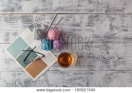 Knitted Background With Knitting Needle And Ball Of Yarn, Knit Is Hobby, Leisure Activities Of Many