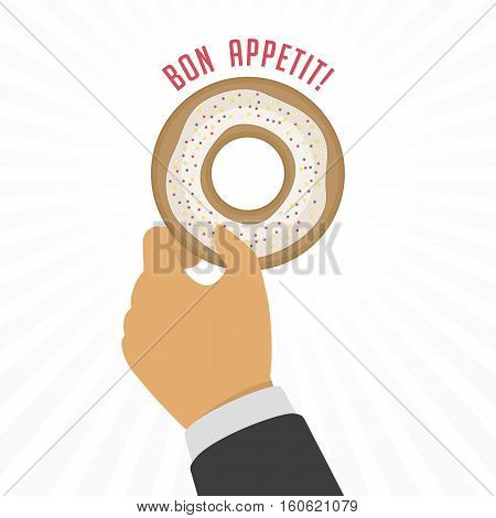 Appetizing tasty donut with white glaze in hand of man. Cream yummy cookie donuts food.