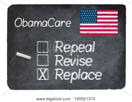 Obamacare health plan choice of Replace written in chalk on a chalky natural slate blackboard isolated against white background
