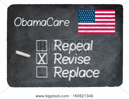 Obamacare health plan choice of Revise written in chalk on a chalky natural slate blackboard isolated against white background