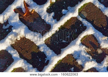 paving in the snow covered pave texture