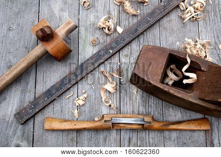 Antique Vintage Ruler, Spokeshave, Mortise Gauge And Block Plane Woodwork Tools On Weathered Wood Ba