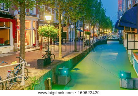 Scenic night view of Oosteinde channel Nieuwe Kerk New Church . Delft. Netherlands.