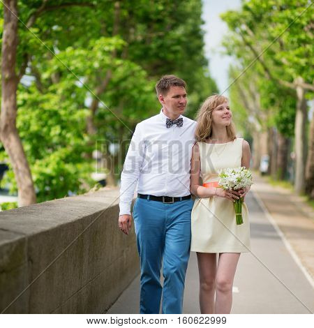Newly-wed Couple Walking Together In Paris