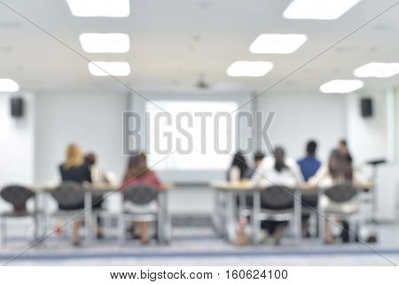 Staff training at the conference room blur background with copy space on white screen, people learning and development.