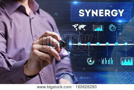 Technology, Internet, Business And Marketing. Young Business Person Sees The Word: Synergy