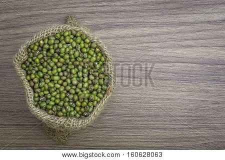 Green Beans In Sack, Isolated On Wooden Texture Background