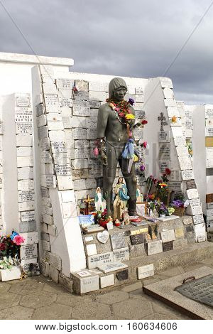 PUNTA ARENAS, CHILE-NOVEMBER 12, 2016:  Monument to the Unknown Indian at the city cemetery.  The monument is visited by locals who leave flowers and offerings in thanks for prayers answered.