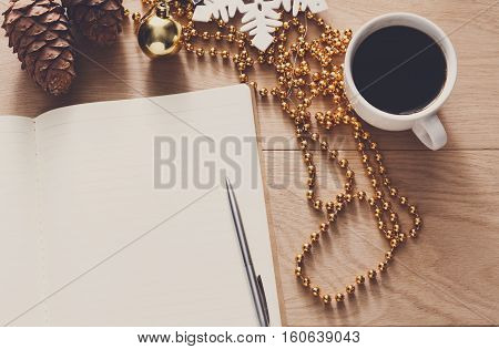 Christmas planning background. Prepare to winter holidays mockup. Top view flat lay of xmas decorations, note papers, pen, coffee on wood. Copy space for wishlist or shedule
