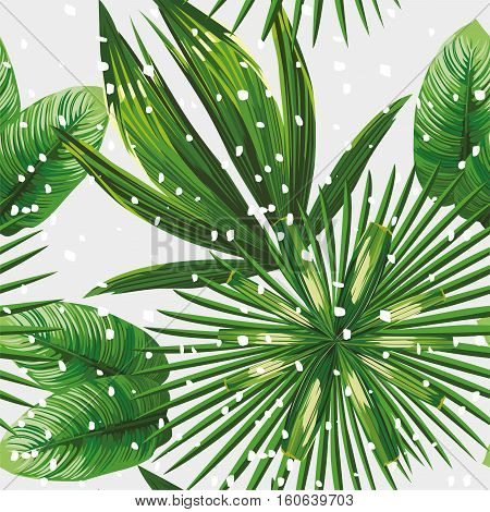 Print exotic jungle plant tropical palm leaves. Pattern seamless floral vector on the snow christmas background. Nature xmas wallpaper.