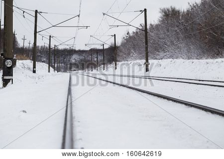 Railway in the winter beautiful forest. Background.