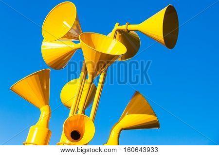 Group Of Yellow Loudspeakers