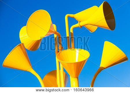 Group Of Bright Yellow Loudspeakers