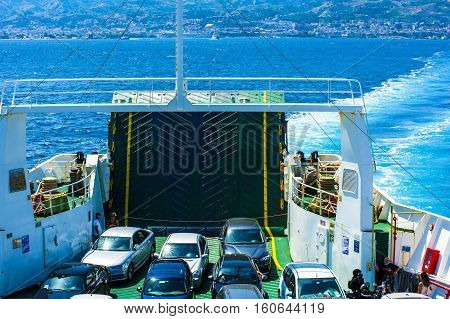 Strait of Messina ITALY - August 18 2016: Top view of vehicles and passengers that use a ferry to cross the Strait of Messina in Italy